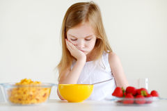 Little girl eating cereal with milk Royalty Free Stock Photography