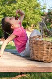 Little girl eating cherries Stock Image