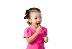 Little girl eating chicken Royalty Free Stock Photo