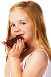 Little girl eating chocolate royalty free stock image