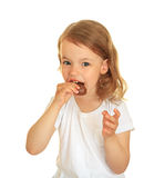 Little girl eating chocolate. Royalty Free Stock Photos