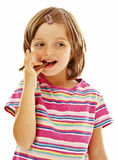 Little girl eating chocolate. On white background Royalty Free Stock Photography