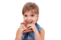 Little girl eating chocolate Stock Photos