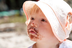Little girl eating chocolate Stock Photography