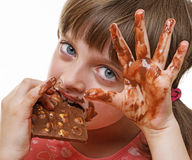 Little girl eating chocolate Stock Photo