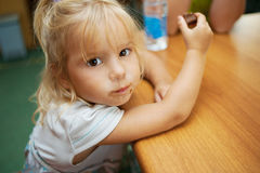 Little girl eating chocolate bar Stock Photo
