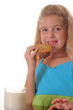 Little girl eating chocolate chip cookie. Photo of a little girl eating chocolate chip cookie Royalty Free Stock Image