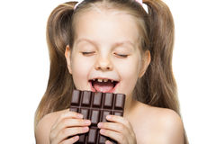 Girl Eating Chocolate Stock Photo - Image: 8026840