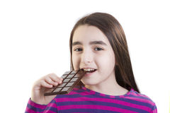 Little girl eating chocolate Royalty Free Stock Images