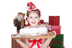 Little girl eating Christmas cake over white Stock Photo