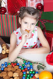 Little girl eating Christmas cookies Royalty Free Stock Photo
