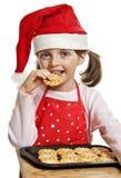 Little girl eating Christmas cookies Stock Photo