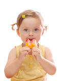 Little girl eating colorful ice lolly. Isolated on white background Stock Photos