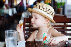 Little girl eating cookie Stock Photo