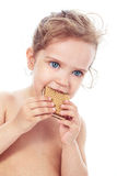 Little girl eating a cookie Royalty Free Stock Images
