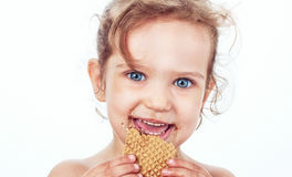 Little girl eating a cookie Royalty Free Stock Photos