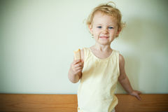 Little girl eating a cookie Stock Photos