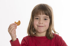 Little girl eating a cookie Stock Photo