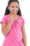 Little girl eating a cookie Stock Photography