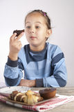 Little girl eating cookies. Close up photo Royalty Free Stock Images