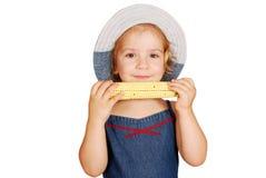 Little girl eating corn Stock Photography