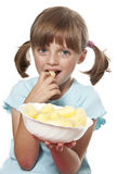 Little girl eating corn snacks Stock Photos