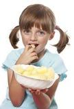 Little girl eating corn snacks Stock Photos
