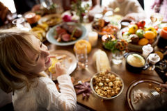 Little Girl Eating Corn Thanksgiving Celebration Concept.  royalty free stock image