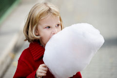 Little girl eating cotton candy Royalty Free Stock Photos