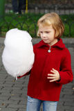 Little girl eating cotton candy Royalty Free Stock Photo