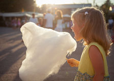 Little girl eating cotton candy Royalty Free Stock Image