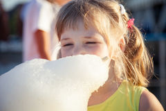 Little girl eating cotton candy Royalty Free Stock Photography