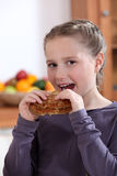 Little girl eating a crepe Stock Image