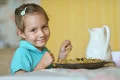 Little girl eating currants Royalty Free Stock Photos