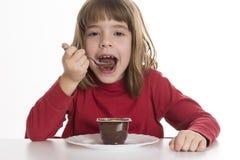 Little girl eating a custard Stock Photo