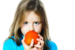 Little girl eating date plum, closeup view Royalty Free Stock Images