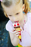 Little girl eating a delicious ice cream Royalty Free Stock Images