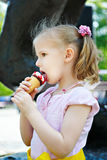 Little girl eating a delicious ice cream stock photography
