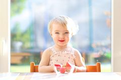 Free Little Girl Eating Delicious Strawberries Royalty Free Stock Images - 47407909