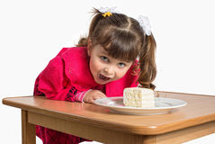 Little girl eating dessert Royalty Free Stock Photos