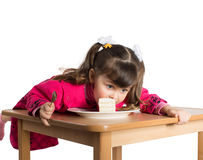 Little girl eating dessert Stock Images