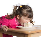 Little girl eating dessert Royalty Free Stock Image