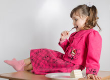 Little girl eating dessert Stock Photo