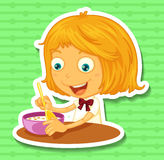 Little girl eating on the dining table Royalty Free Stock Photography