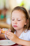 Little girl eating donut Stock Image