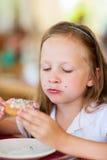 Little girl eating donut Stock Image