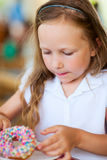 Little girl eating donut Royalty Free Stock Images