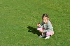 Little girl  eating donut Stock Photos
