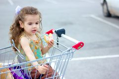 Little girl eating a donut Royalty Free Stock Images