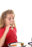 Little girl eating eggs Royalty Free Stock Photo